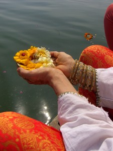 Yoga teacher Betty Roi makes an offering to the Ganges