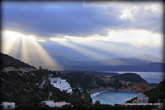 Lasithi sun rays over sea cove on Crete
