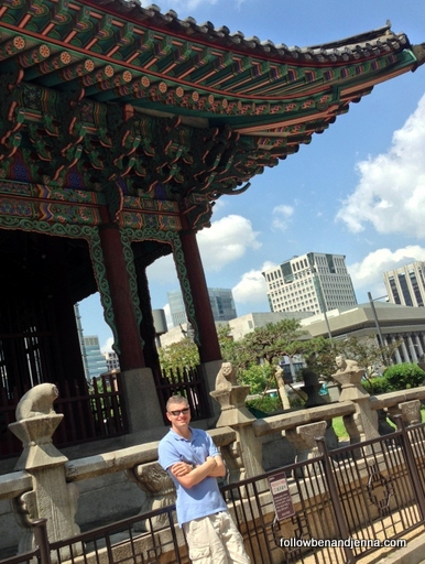Ben at a gate on Sejong-daero, framed by modern buildings